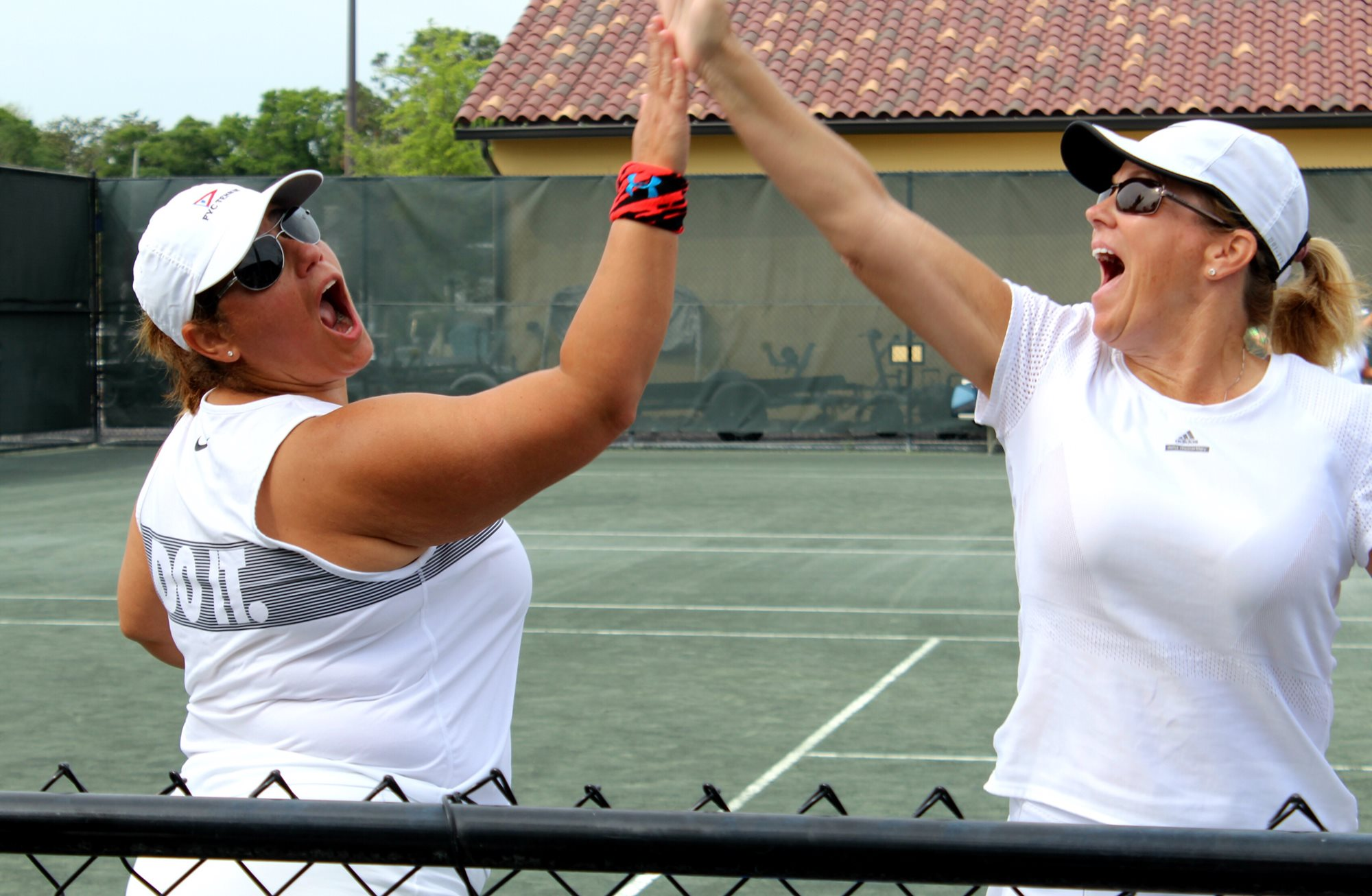 Two tennis players high-fiving