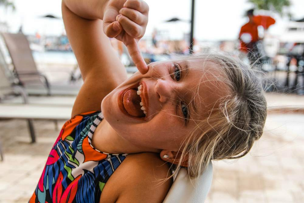 child smiling by the pool